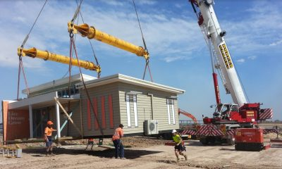 large modular building on crane